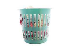 Green laundry basket full of  clothes  on white background , wit Royalty Free Stock Images