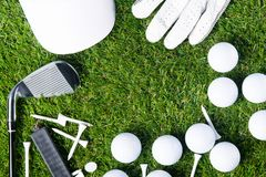 On a green lawn for a background lined with golf equipment, there is a place for an inscription. On a green lawn for a background lined with golf equipment Royalty Free Stock Photo