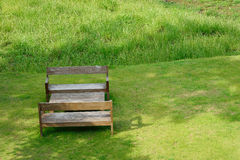 Green lawn and benches Stock Photo