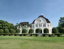 Green lawn and bright blue sky over Phra Ram Ratchaniwet  originally called Wang Ban Pun, Thailand Stock Photo