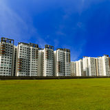 Green lawn and highrise-Singapore Royalty Free Stock Image