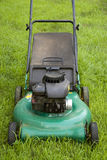 Green Lawn Mower. A green push style lawn mower ready for some weekend action Royalty Free Stock Image