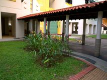 Green lawn near the multi storey building royalty free stock photo