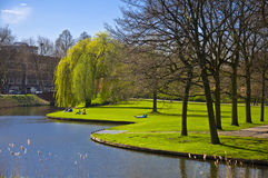 Green Lawn On The Canal Bank Royalty Free Stock Image