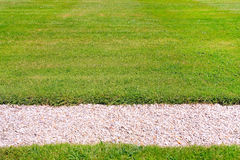 Green lawn and pebbles path Royalty Free Stock Photo