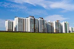 Green lawn and public highrise-Singapore. Public housing apartment and green lawn at the front. Focus at the central part of the buildings Stock Photos