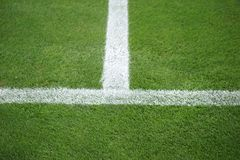 Sideline football field. The green lawn surface of a soccer field with the side line and the center line royalty free stock photo