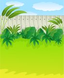 Green lawn and wooden fence. Vector illustration Royalty Free Stock Photography