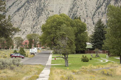 Green lawns in arid environment on federal land, Yellowstone Par. Headquarters area in Yellowstone National Park, with green grass lawns despite arid environment Stock Photo