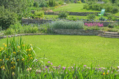 Green lawns and flower beds in the garden Stock Image