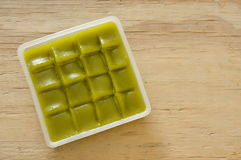 Green layer sweet sticky cake Thai dessert on tray. Green layer sweet sticky cake Thai dessert on plastic tray Stock Photos