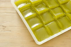 Green layer sweet sticky cake Thai dessert on tray. Green layer sweet sticky cake Thai dessert on plastic tray Royalty Free Stock Image