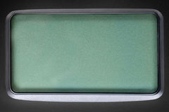 Green LCD screen in black plastic frame. Template, texture and background Royalty Free Stock Photo