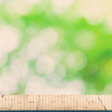 Green leaf bokeh blur and wood table. For natural background Stock Photography