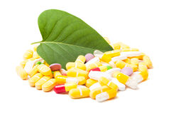 Green leaf and bunch of pills Royalty Free Stock Image