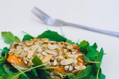 Green Leaf Covering Meat With Sesame Seeds With a Fork on the Side Stock Images