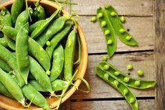 Green leaf, healthy food concept with fresh snap peas Royalty Free Stock Photo