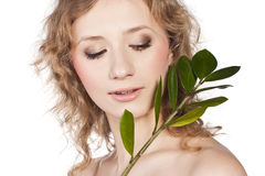 Green leaf near beauty woman Royalty Free Stock Photo