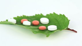 Green leaf with pills turning on itself stock footage