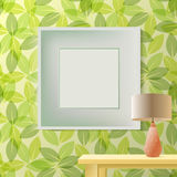 Green leaf spring printed wallpaper with frame for copyspace. Green leaf spring printed wallpaper with empty frame for copyspace on wall, elegant fresh interior Stock Photos