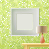 Green leaf spring printed wallpaper with frame for copyspace. Green leaf spring printed wallpaper with empty frame for copyspace on wall, elegant fresh interior Stock Image