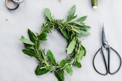 Green Leaf Wreath on White Surface stock photos