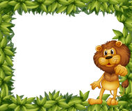 A green leafy frame with a lion Stock Photos