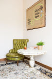Green leather armchair and table Stock Image