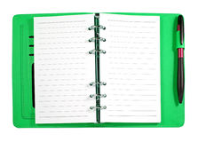 Green leather binder notebook with pen isolated Royalty Free Stock Image