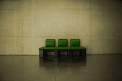 A green leather couch Stock Images
