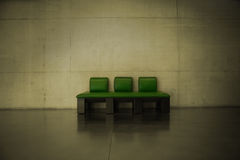 A green leather couch Stock Image