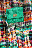 Green leather handbag. On a colored background Royalty Free Stock Images