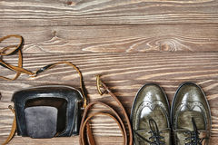 Green leather shoes and retro style camera Stock Images