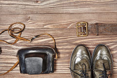 Green leather shoes and retro style camera Stock Photos