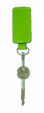Green leather tag and a keychain Royalty Free Stock Photos