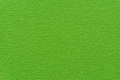 Green leather texture closeup, useful as background. Royalty Free Stock Images