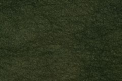 Green leather texture closeup, useful as background. Stock Photo