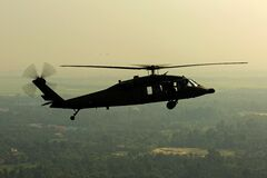 Green Leaved Trees Under Black Helicopter stock photo