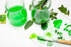 Green leaves draws the artist. Concept art. Workplace, designer Royalty Free Stock Photography