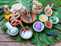 Green leaves with nature spa ingredient turmeric powder in white Stock Photos