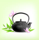 Green leaves and teapot Royalty Free Stock Photos