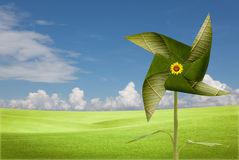 Green leaves windmill on meadow Royalty Free Stock Image