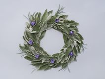 Green leaves wreath. Round frame wreath pattern with green leaves and blue flowers. Top view, flat lay Stock Photos