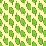Green leaves on yellow background. Organic seamless pattern. Stock Photos