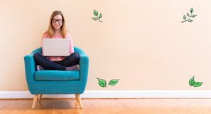 Green Leaves with young woman using her laptop Stock Photos