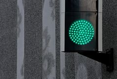 Green led light on a wall stock photo