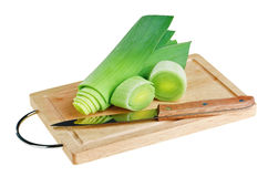 Green leek with knife on wooden chopping board Stock Photography