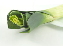 Leek on a plate  on white Stock Images