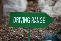 Green left arrow towards the driving range Stock Images