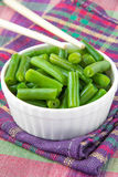 Green beans in white cup with chopsticks Royalty Free Stock Image